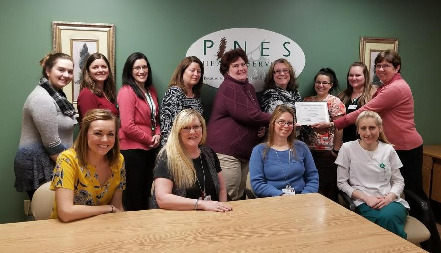 Pines Care Coordination Team Receiving the Patient Service Award